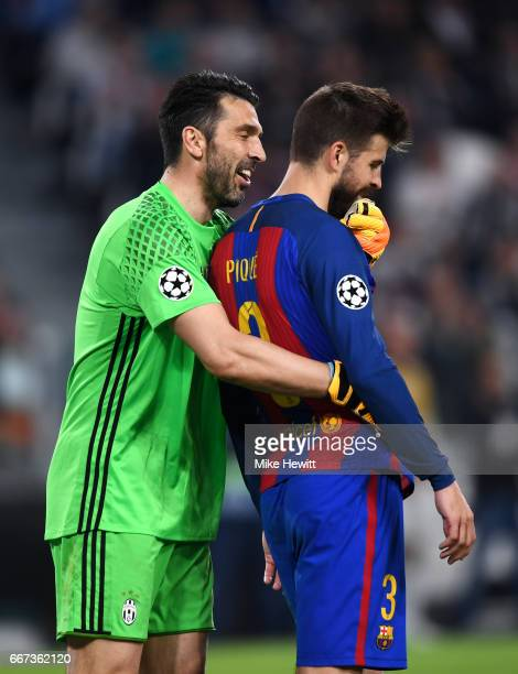 Gianluigi Buffon of Juventus hugs Gerard Pique of Barcelona during the UEFA Champions League Quarter Final first leg match between Juventus and FC...
