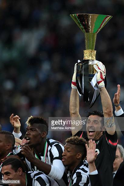 Gianluigi Buffon of Juventus lifts the Scudetto Winners Trophy after winning Serie A