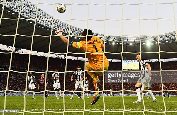 Gianluigi Buffon of Juventus makes a save during the UEFA Champions League Final between Juventus and FC Barcelona at Olympiastadion on June 6 2015...