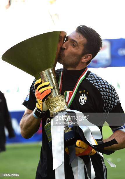 Gianluigi Buffon of Juventus poses the 'Scudetto' trophy to celebrate the win of the Italian Serie A 2016/2017 at the end of the Serie A match...