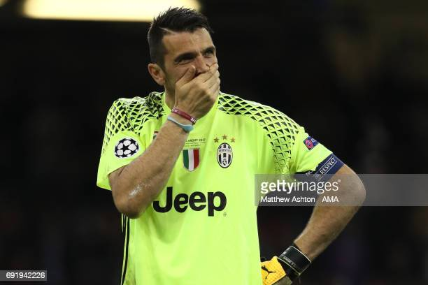 Gianluigi Buffon of Juventus reacts at the end of the UEFA Champions League Final between Juventus and Real Madrid at National Stadium of Wales on...