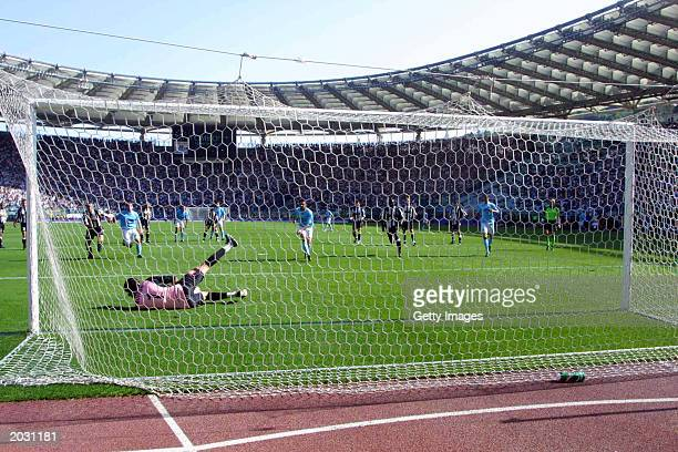 Gianluigi Buffon of Juventus saves a penalty during the Serie A match between Lazio and Juventus played on May 3 2003 at the Olympic Stadium Rome...