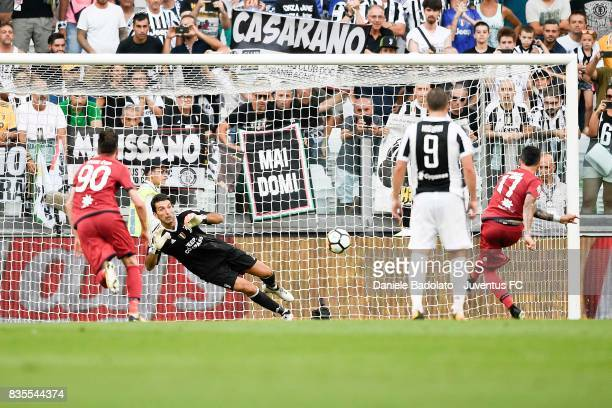 Gianluigi Buffon of Juventus saves the penalty during the Serie A match between Juventus and Cagliari Calcio at Allianz Stadium on August 19 2017 in...