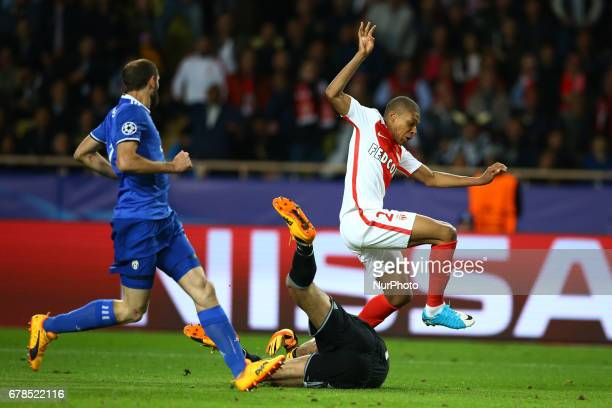 Gianluigi Buffon of Juventus saving on Kylian Mbappe of Monaco during the UEFA Champions League Semi Final first leg match between AS Monaco v...