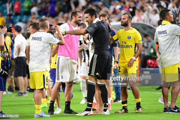 Gianluigi Buffon of Juventus shares a joke with Marco Verratti of PSG after the International Champions Cup match between Paris Saint Germain and...