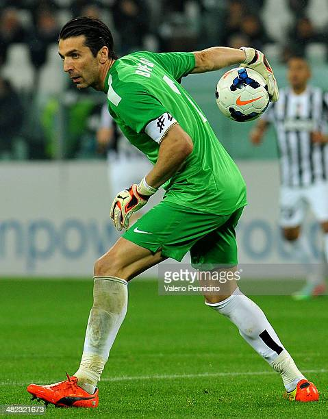Gianluigi Buffon of Juventus throws the ball during the serie A match between Juventus and Parma FC at Juventus Arena on March 26 2014 in Turin Italy