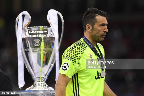Gianluigi Buffon of Juventus walks past the Champions League Trophy after the UEFA Champions League Final between Juventus and Real Madrid at...