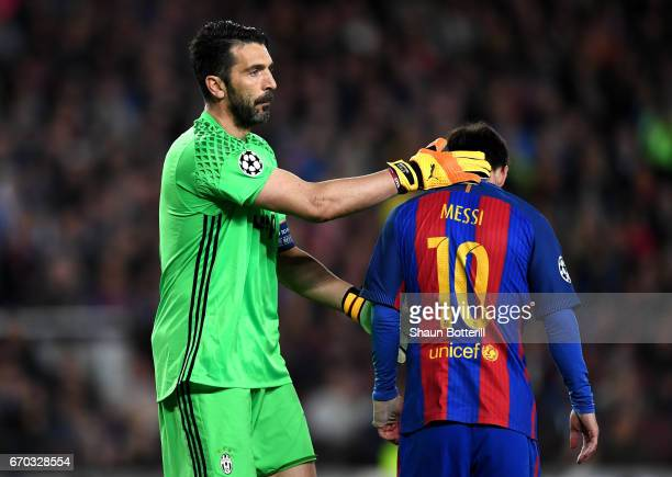Gianluigi Buffon ofJuventus pats Lionel Messi of Barcelona on the back during the UEFA Champions League Quarter Final second leg match between FC...