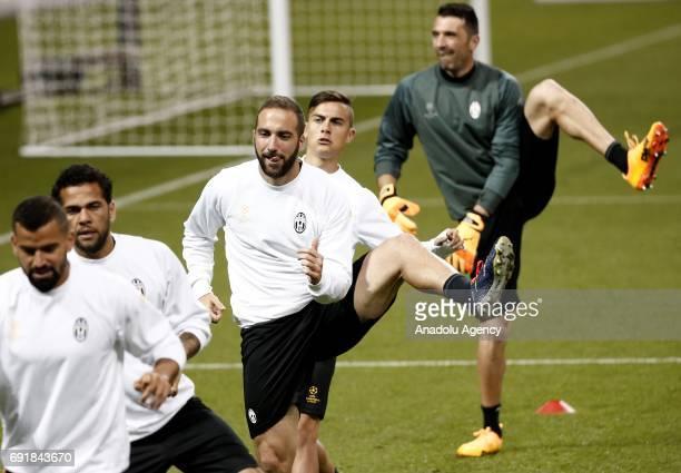 Gianluigi Buffon Paulo Dybala Gonzalo Higuain Dani Alves and Tomas Rincon of Juventus attend a training session ahead of the UEFA Champions League...