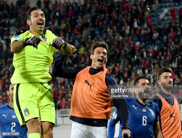 Gianluigi Buffon Roberto Inglese and Antonio Candreva of Italy celebrate at the end of the FIFA 2018 World Cup Qualifier between Albania and Italy at...