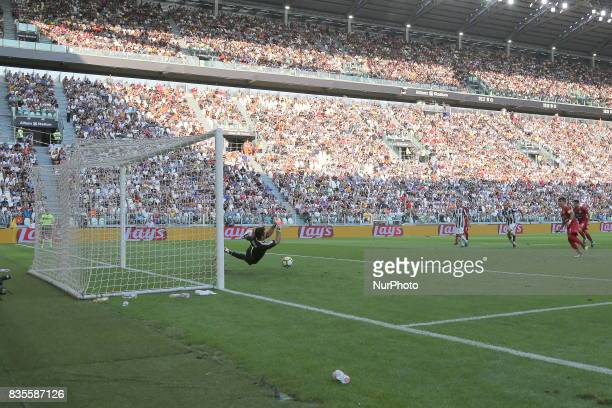 Gianluigi Buffon saves the penalty of Diego Farias during the Serie A football match between Juventus FC and Cagliari Calcio at Allianz Stadium on...