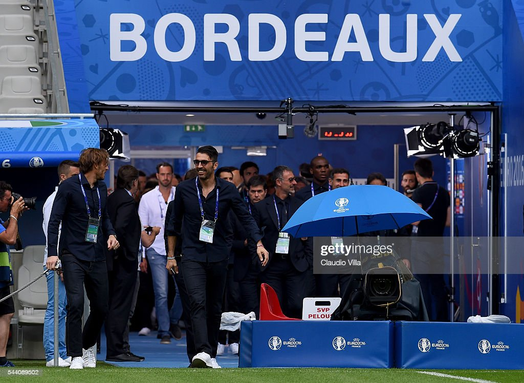 <a gi-track='captionPersonalityLinkClicked' href=/galleries/search?phrase=Gianluigi+Buffon&family=editorial&specificpeople=208860 ng-click='$event.stopPropagation()'>Gianluigi Buffon</a> (R) smiles during Italy pitch walkabout ahead of tomorrow's UEFA Euro 2016 quarter final match against Germany at Stade de Bordeaux on July 1, 2016 in Bordeaux, France.