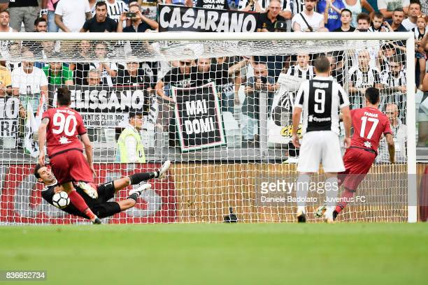 Gianluigi Buffon stops Diego Farias penalty kick during the Serie A match between Juventus and Cagliari Calcio at Allianz Stadium on August 19 2017...