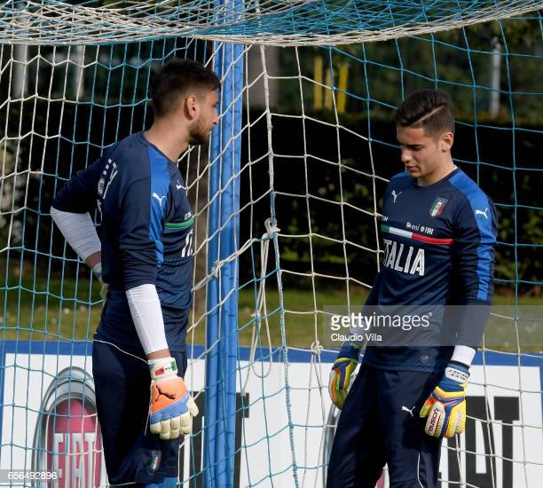Gianluigi Donnarumma and Alex Meret of Italy look on during the training session at the club's training ground at Coverciano on March 22 2017 in...