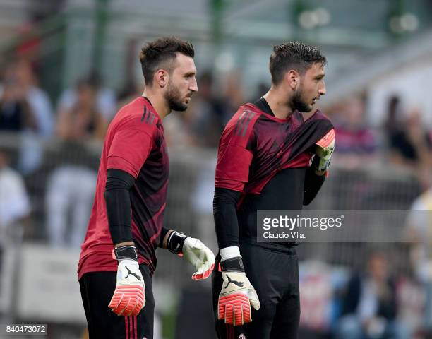 Gianluigi Donnarumma and Antonio Donnarumma of AC Milan warm up prior to the Serie A match between AC Milan and Cagliari Calcio at Stadio Giuseppe...