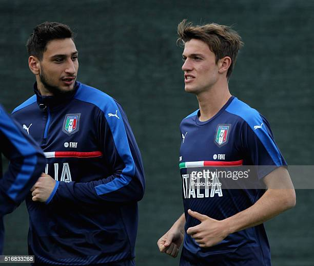 Gianluigi Donnarumma and Daniele Rugani of Italy in action during the Italy U21 training session on March 21 2016 in Rome Italy