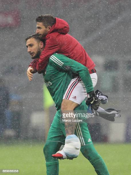 Gianluigi Donnarumma and Fabio Borini of AC Milan celebrate a victory at the end of the Serie A match between AC Milan and Bologna FC at Stadio...