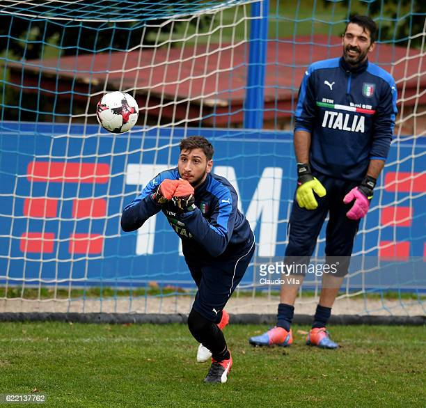 Gianluigi Donnarumma and Gianluigi Buffon in action during the training session at the club's training ground at Coverciano on November 10 2016 in...