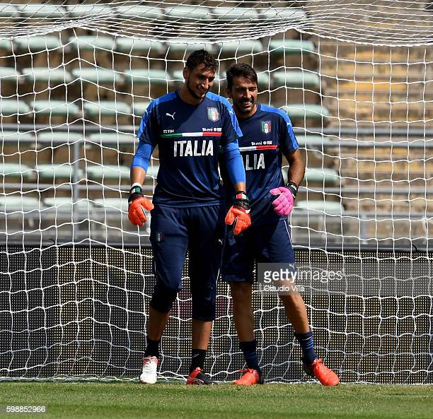 Gianluigi Donnarumma and Gianluigi Buffon of Italy chat during the Italy training session at Stadio San Nicola on September 3 2016 in Bari Italy