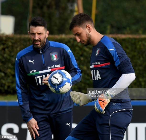 Gianluigi Donnarumma and Gianluigi Buffon of Italy in action during the training session at the club's training ground at Coverciano on March 22 2017...