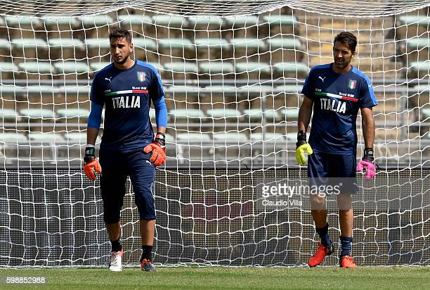 Gianluigi Donnarumma and Gianluigi Buffon of Italy look on during the Italy training session at Stadio San Nicola on September 3 2016 in Bari Italy
