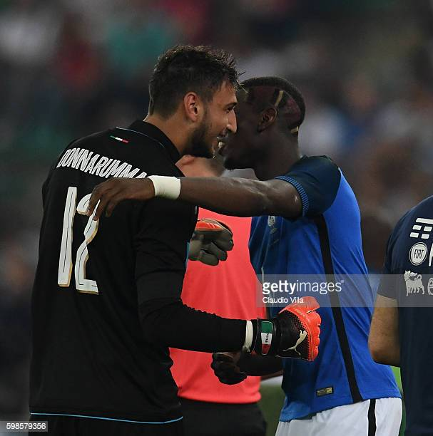 Gianluigi Donnarumma and Paul Pogba of France chat at the end of the international friendly match between Italy and France at Stadio San Nicola on...