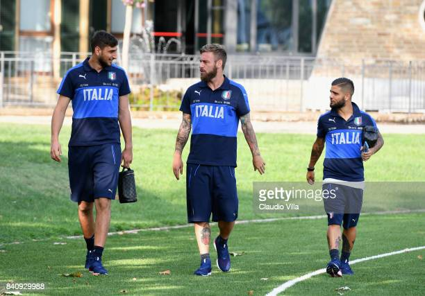 Gianluigi Donnarumma Daniele De Rossi and Lorenzo Insigne of Italy chat prior to the traning session at Coverciano on August 30 2017 in Florence Italy