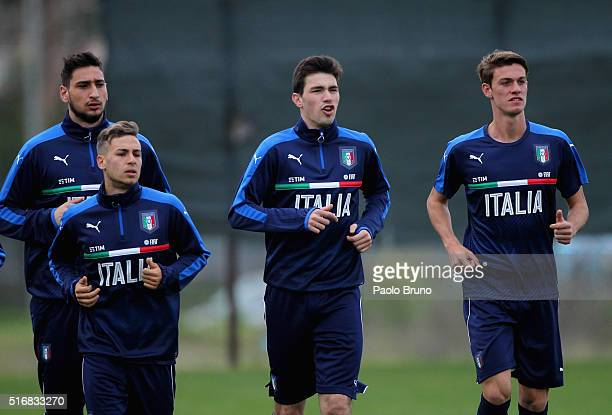Gianluigi Donnarumma Federico Ricci Alessio Romagnoli and Daniele Rugani of Italy in action during the Italy U21 training session on March 21 2016 in...