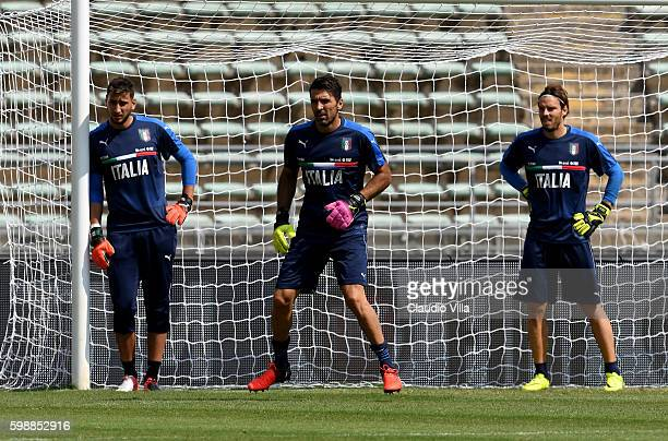 Gianluigi Donnarumma Gianluigi Buffon and Federico Marchetti of Italy look on during the Italy training session at Stadio San Nicola on September 3...