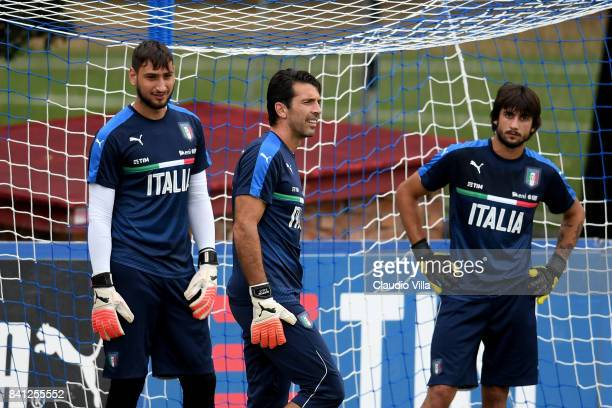 Gianluigi Donnarumma Gianluigi Buffon and Mattia Perin of Italy look on during the training session at Italy club's training ground at Coverciano on...