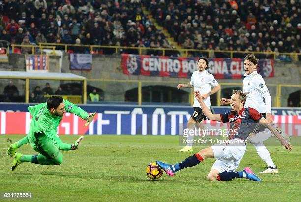 Gianluigi Donnarumma goalkeeper of AC MIlan saves his goal during the Serie A match between Bologna FC and AC Milan at Stadio Renato Dall'Ara on...