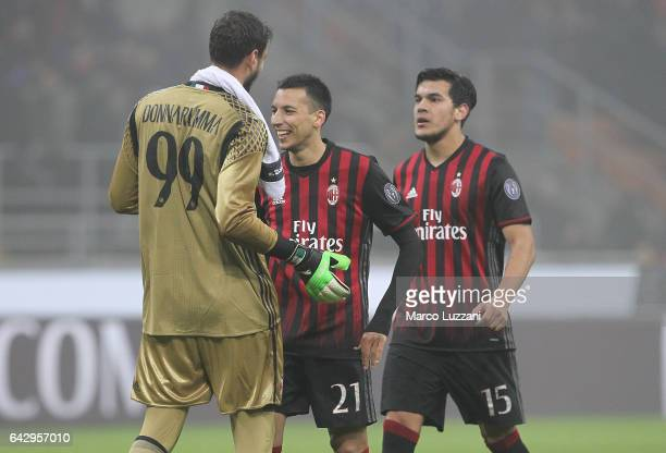 Gianluigi Donnarumma Leonel Vangioni and Gustavo Gomez of AC Milan celebrate a victory at the end of the Serie A match between AC Milan and ACF...