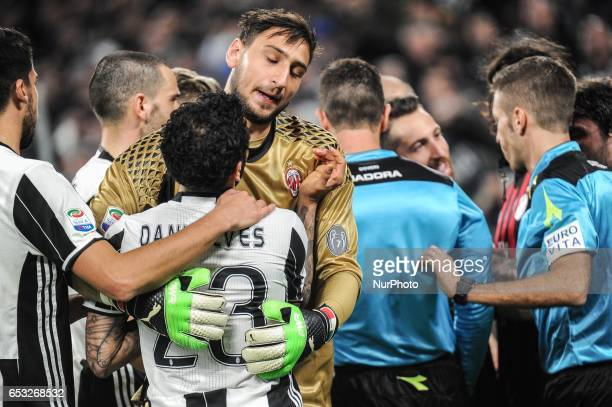 Gianluigi Donnarumma of AC Milan and Dani Alves of Juventus react at the end of the Serie A match between Juventus FC and AC Milan at Juventus...