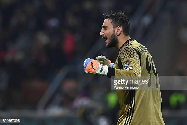 Gianluigi Donnarumma of AC Milan celebrates after his team mate Fernandez Suso scored the opening goal during the Serie A match between AC Milan and...
