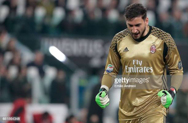 Gianluigi Donnarumma of AC Milan celebrates after his teammate Carlos Bacca scored during the Serie A match between Juventus FC and AC Milan at...