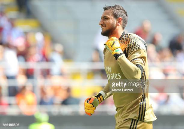 Gianluigi Donnarumma of AC Milan celebrates his teammates goal during the Serie A match between AC Milan and US Citta di Palermo at Stadio Giuseppe...