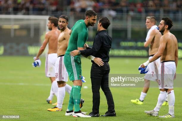 Gianluigi Donnarumma of AC Milan celebrates the victory with head coach of AC Milan Vincenzo Montella after UEFA Europa League Qualifying Round match...