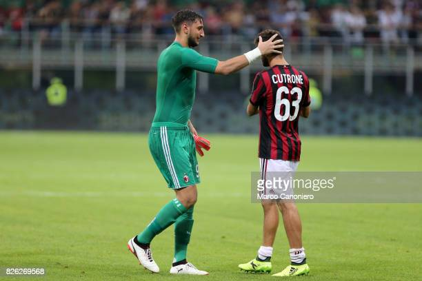 Gianluigi Donnarumma of AC Milan celebrates the victory with hih teammates Patrick Cutrone after UEFA Europa League Qualifying Round match between AC...