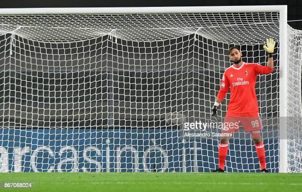Gianluigi Donnarumma of AC Milan gestures during the Serie A match between AC Chievo Verona and AC Milan at Stadio Marc'Antonio Bentegodi on October...