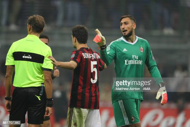 Gianluigi Donnarumma of AC Milan gets a yellow card from the referee during to the Serie A match between FC Internazionale and AC Milan at Stadio...