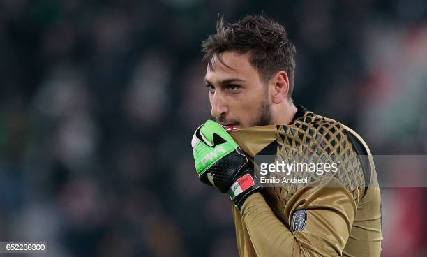 Gianluigi Donnarumma of AC Milan kisses his shirt during the Serie A match between Juventus FC and AC Milan at Juventus Stadium on March 10 2017 in...