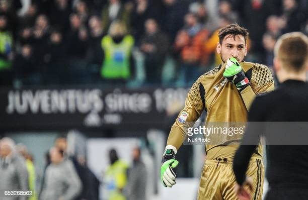 Gianluigi Donnarumma of AC Milan reacts with a refeer at the end of the Serie A match between Juventus FC and AC Milan at Juventus Stadium on March...