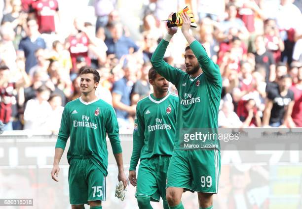 Gianluigi Donnarumma of AC Milan salutes the fans at the end of the Serie A match between AC Milan and Bologna FC at Stadio Giuseppe Meazza on May 21...