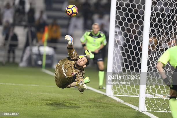 Gianluigi Donnarumma of AC Milan saves the shoot during the Italian Super Cup final match between Juventus and AC Milan at Jassim Bin Hamad Stadium...
