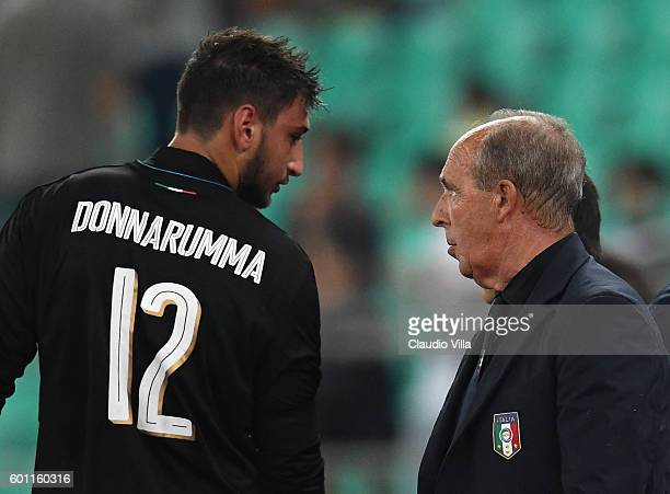 Gianluigi Donnarumma of Italy and head coach Italy Gian Piero Ventura chat during the international friendly match between Italy and France at Stadio...