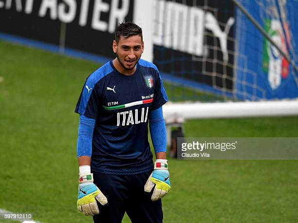 Gianluigi Donnarumma of Italy smiles during the training session at the club's training ground at Coverciano on August 30 2016 in Florence Italy