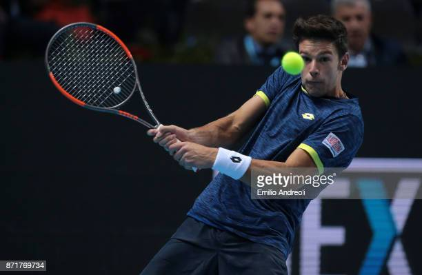 Gianluigi Quinzi of Italy returns a backhand in his match against Denis Shapovalov of Canada during Day 2 of the Next Gen ATP Finals on November 8...