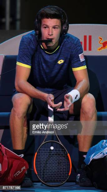 Gianluigi Quinzi of Italy speaks with his coach during time out through the headphones in his match against Denis Shapovalov of Canada during Day 2...