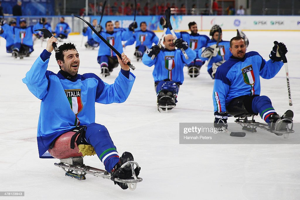 Gianluigi Rosa of Italy celebrates with his team after winning the Ice Sledge Hockey Classification match between Italy and Sweden at the Shayba Arena during day five of the 2014 Paralympic Winter Games on March 12, 2014 in Sochi, Russia.