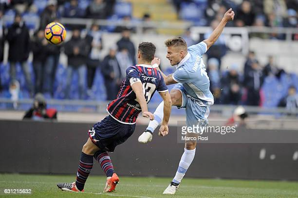 Gianmaco Ferrari of FC Crotone compete for the ball with Ciro Immobile of SS Lazio during the Serie A match between SS Lazio and FC Crotone at Stadio...